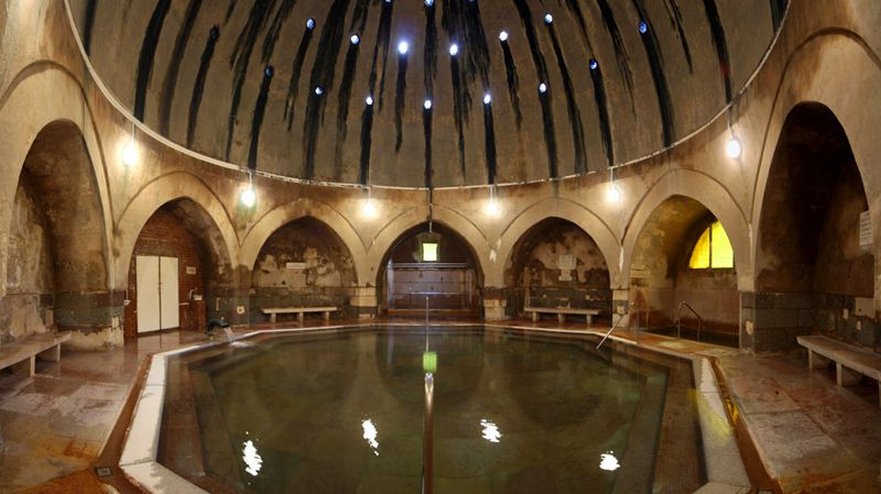 An indoor thermal bath with a massive domed ceiling
