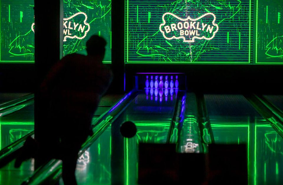 Someone bowling at glow in the dark bowling at Brooklyn Bowl Las vegas