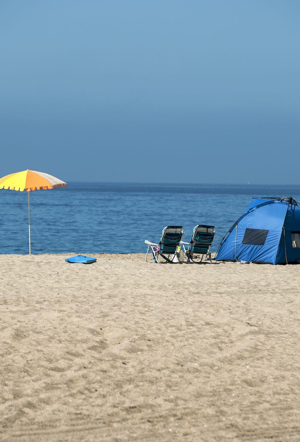 Parasol and tent at a beach campsite, Point Mugu Beach, Ventura County, California