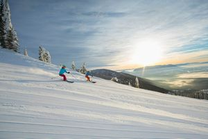 Couple skiing at sunset