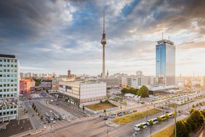 View from above on the Alexanderplatz in Berlin with moody heaven on a summer evening.