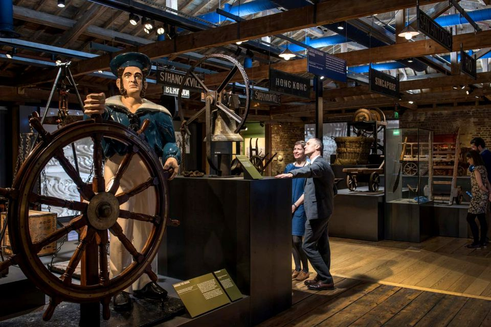 A sculpture of a ship's helmans, which once stood on the roof of Bawn & Co. Mast-Makers in West India Dock Road and became a local landmark advertising the Bawns' carving skills, now dominates the No. 1 Warehouse exhibition at the Museum of London Docklands