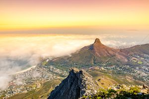 View of fog over Cape Town and Lion's Head, from the top of Table Mountain