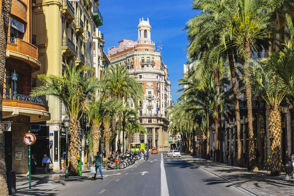 Сarrer de les Barques street with palm trees on a sunny day in Valencia, Spain
