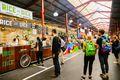 People in line at a vendor in Queen Victoria Market