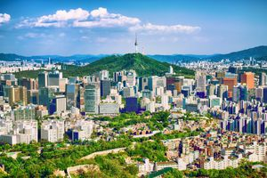 Seoul downtown cityscape with fortress and Namsan Seoul Tower on sunset Seoul, South Korea.