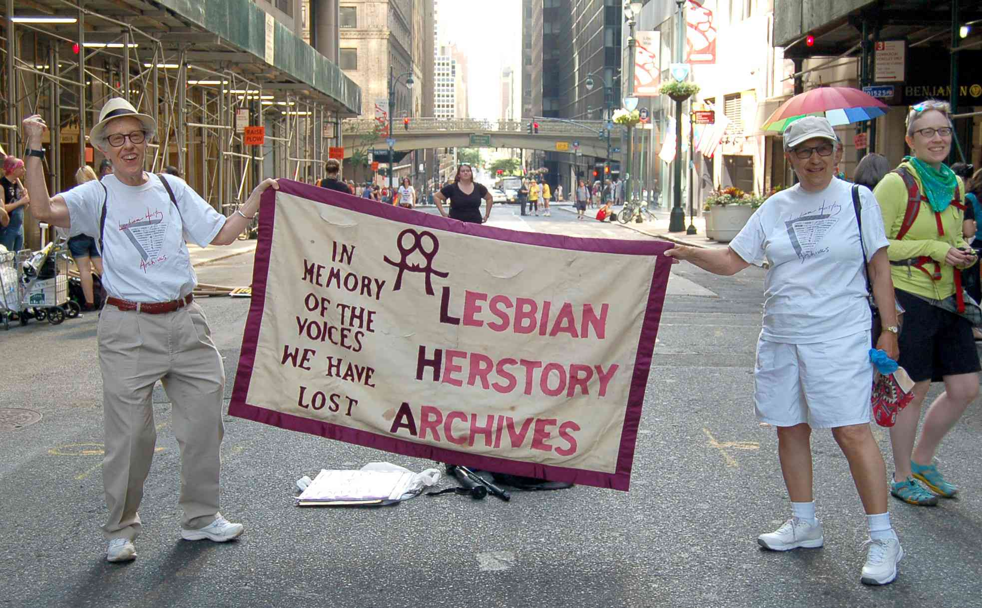 two women holding a banner for the Lesbian Herstory Archives