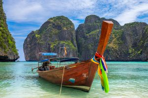 A longtail boat with colorful bow at Koh Phi Phi island, Thailand