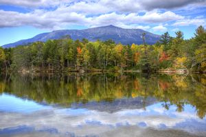 Mount Katahdin is the highest mountain in Maine. Katahdin is the centerpiece of Baxter State Park: a steep, tall mountain formed from underground magma.