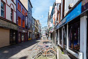 Empty pedestrian street in Cork with bikes parked