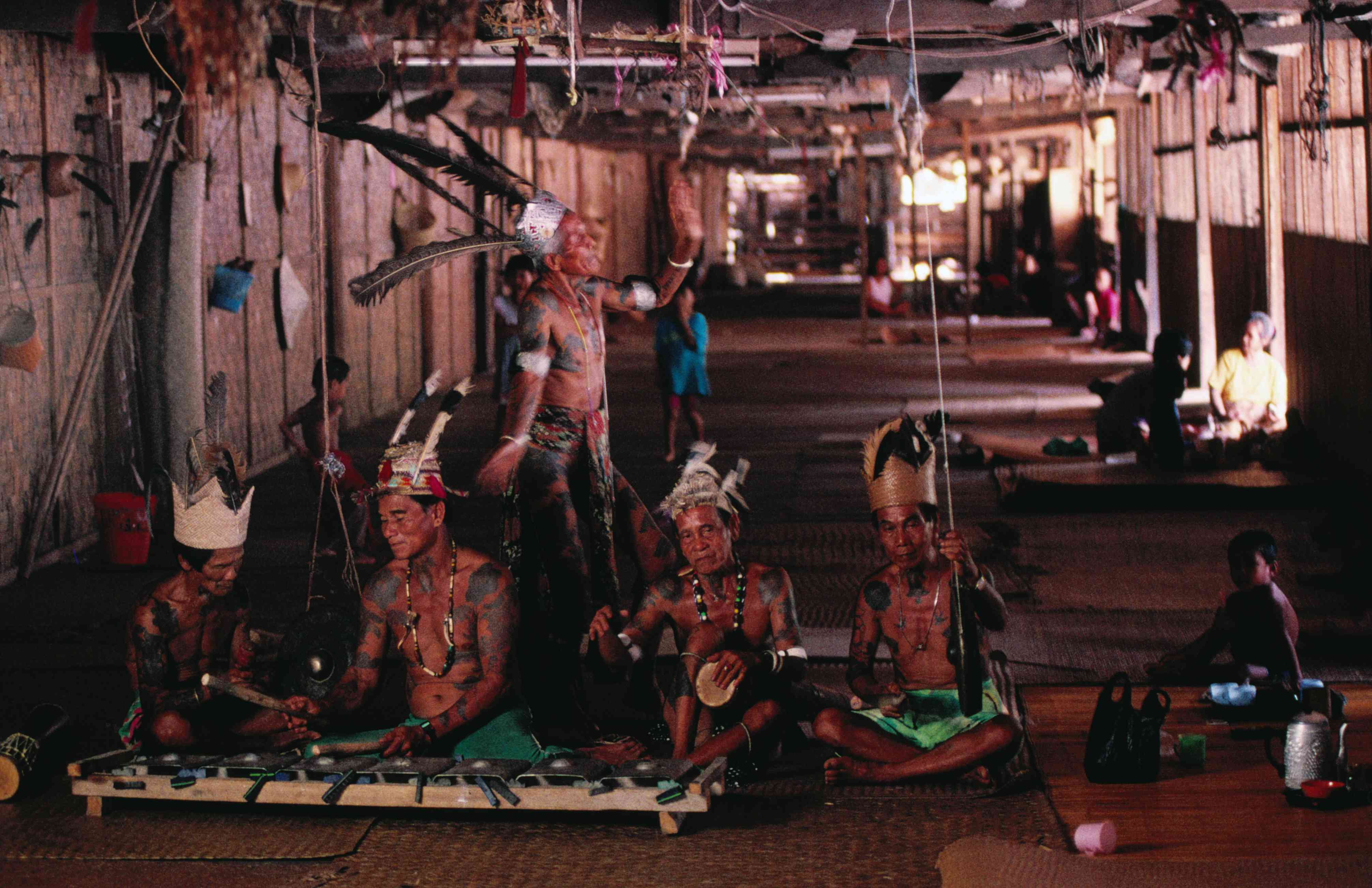 Iban tribesmen in a longhouse in Sarawak, Borneo