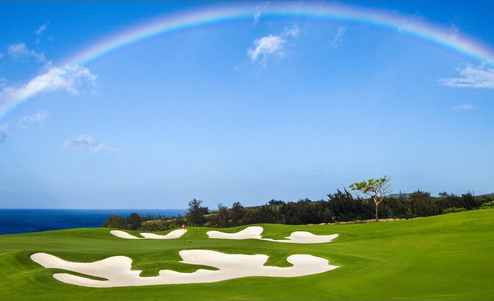 golf course sand traps with a rainbow overhead