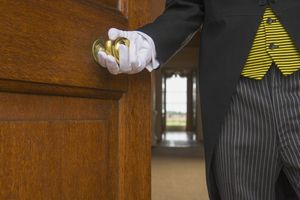 Close up of butler opening door