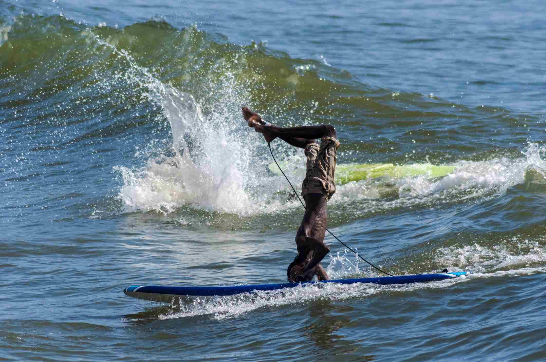 Surfer at Kovalam, Tamil Nadu.