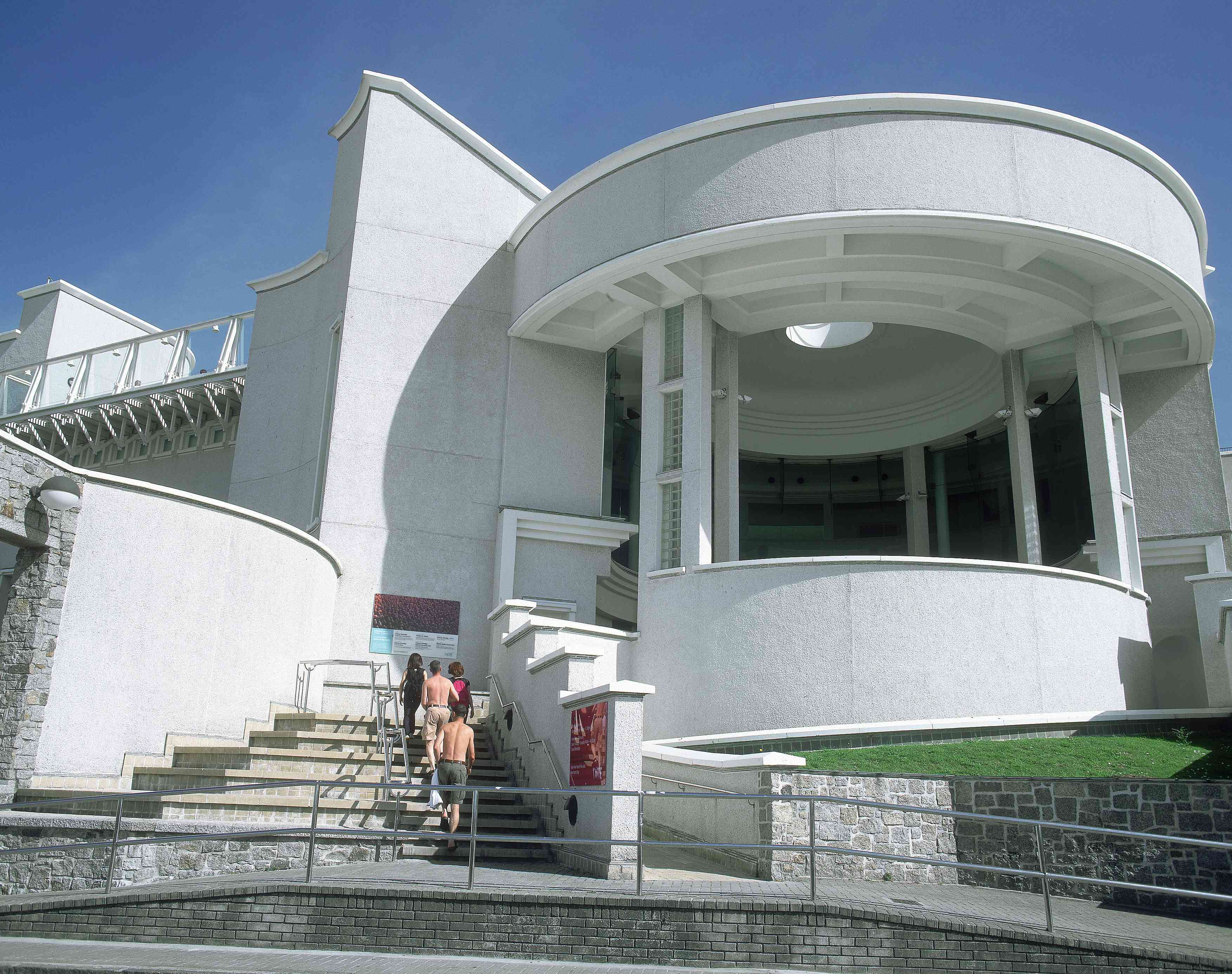 Visitors climbing the steps of the round pavilion of the Tate St Ives