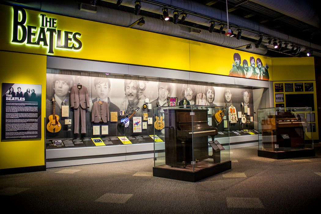 Pianos in glass cases at the beatles exhibit in the Rock and Roll Hall of Fame