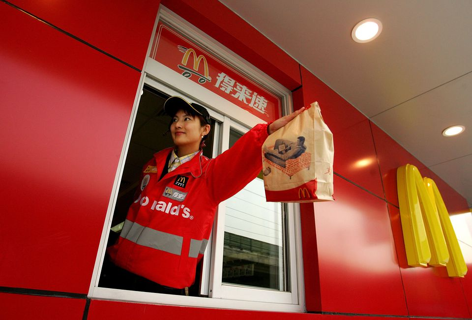 A Chinese woman serving food at a McDonald's drive-thru in Beijing
