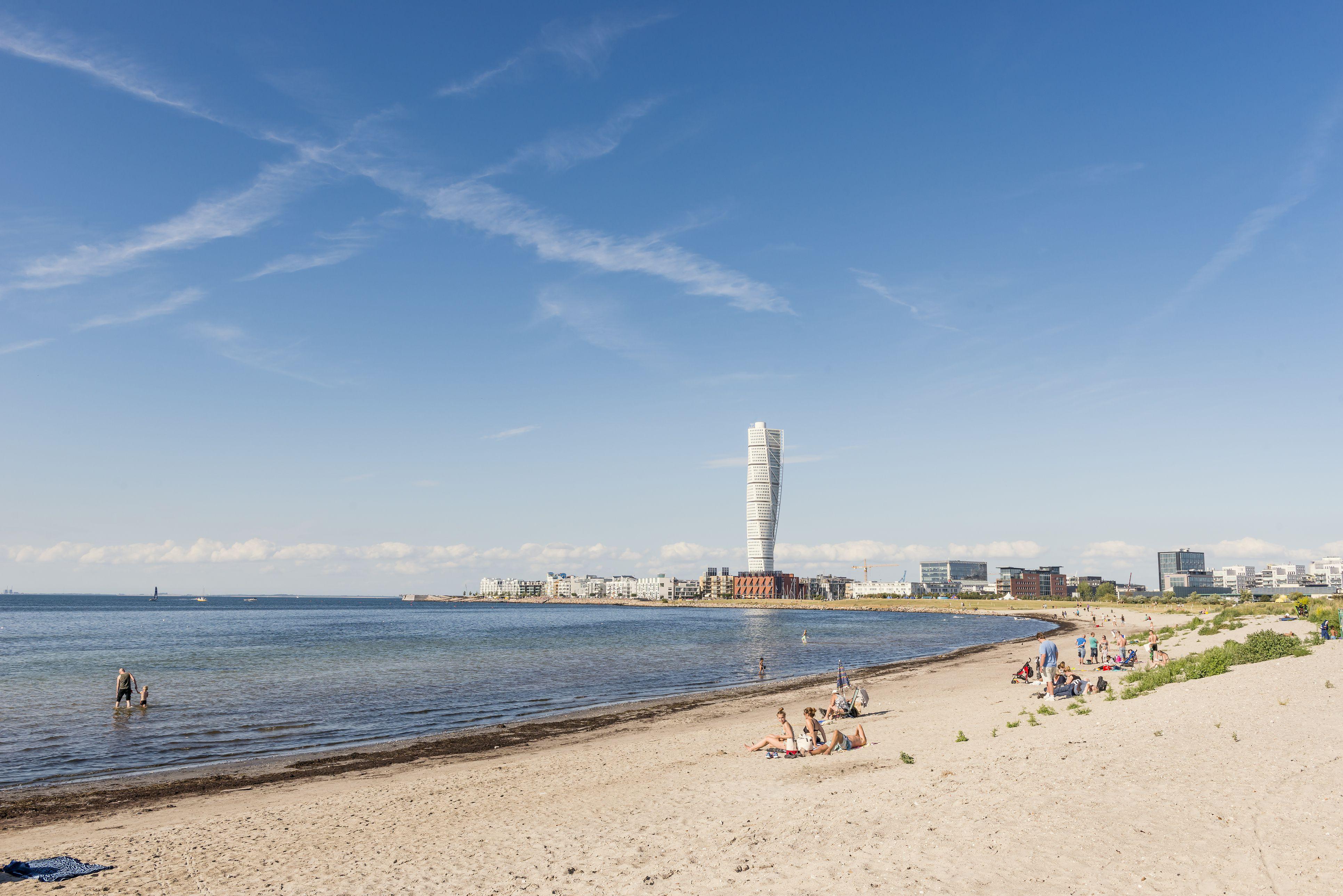'Sweden, Skane, Malmo, Ribersborg, Coastline with Turning Torso in background'