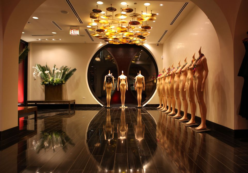 row of mannequins against a way in a showroom