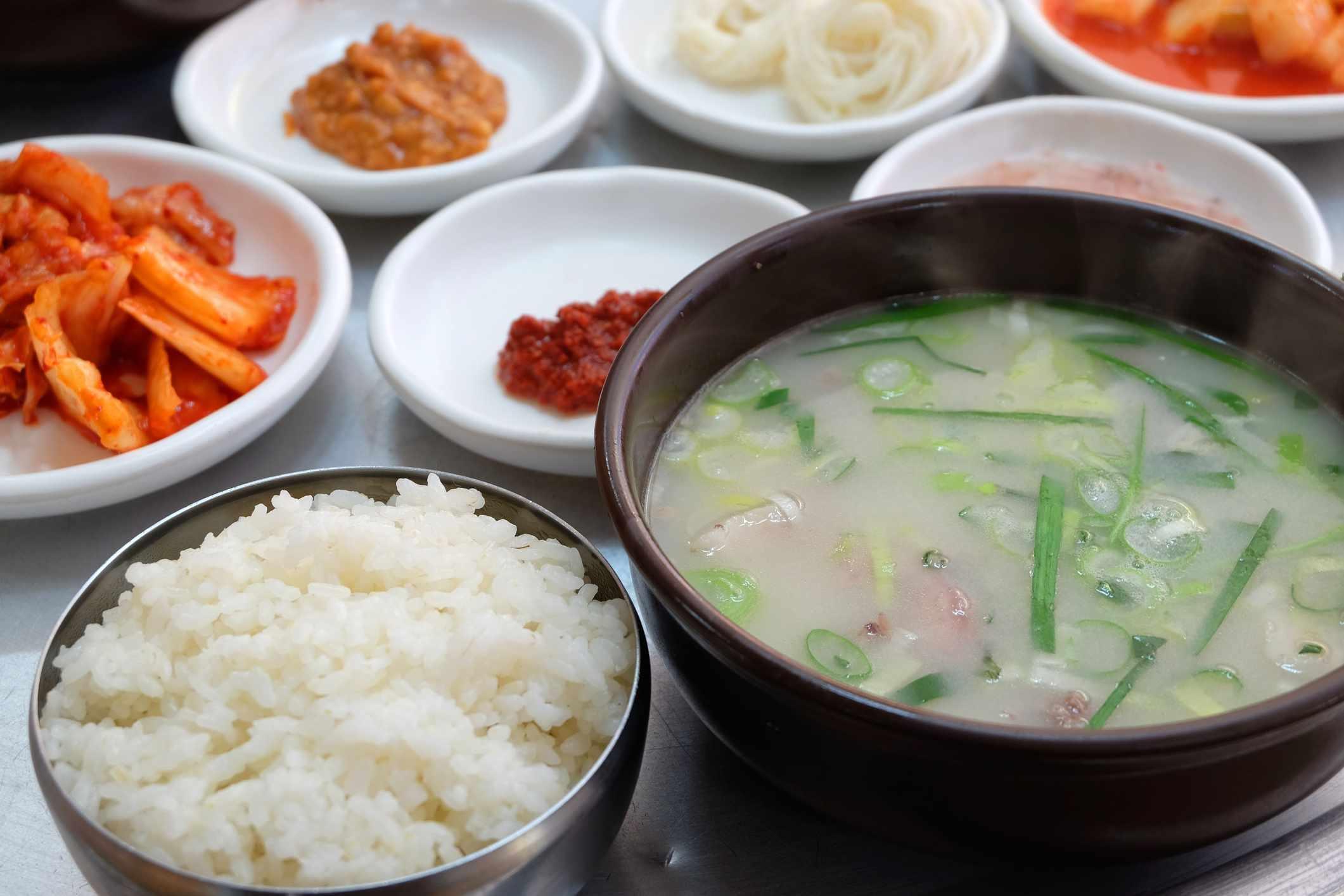Korean food Dwaeji-gukbap. Rice and pork soup in a steaming stone bowl.