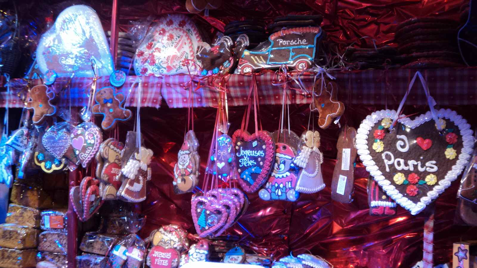 Traditional gingerbread and Christmas cookies lure visitors from a stand at a Parisian holiday market
