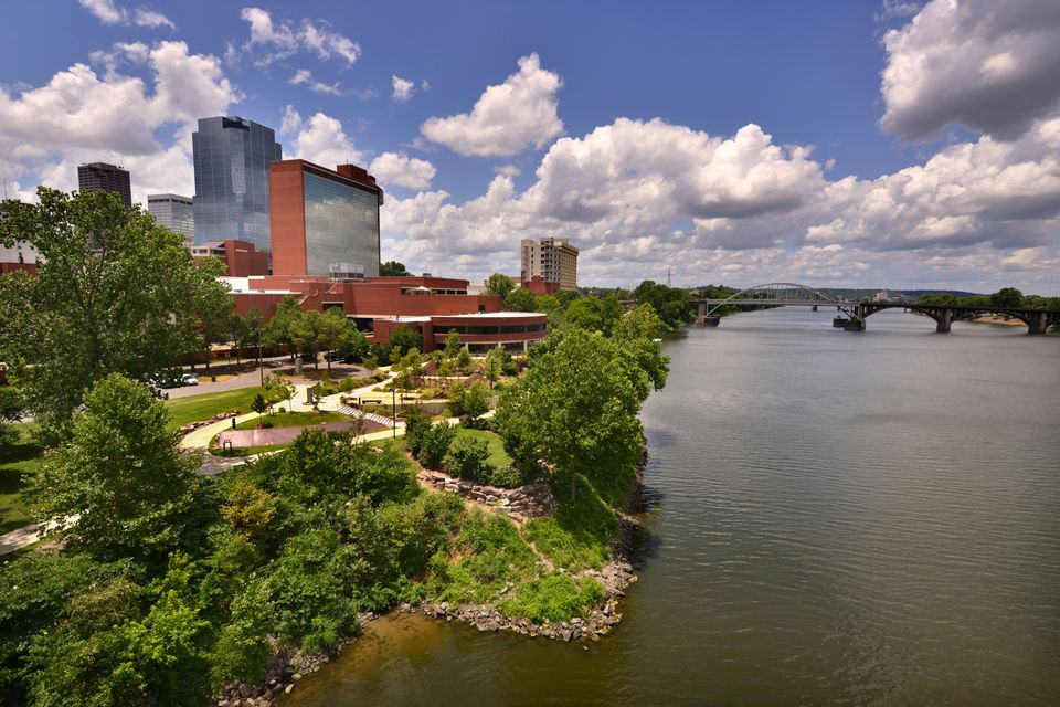 'Riverfront area of downtown Little Rock, Arkansas, on the Arkansas River on a sunny summer day.'
