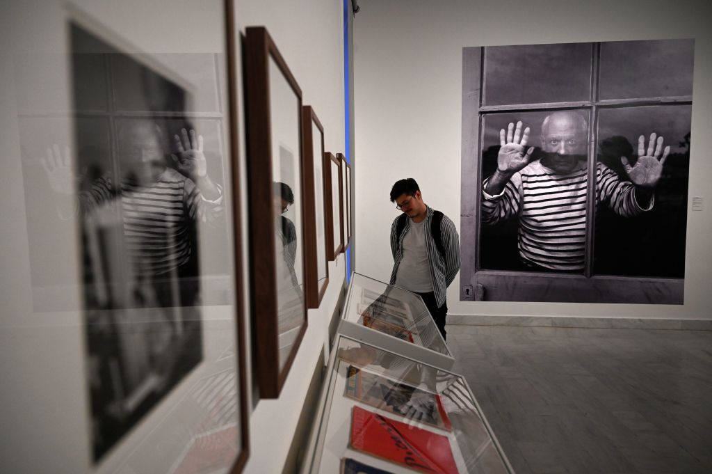 A man visits the photo-exhibition