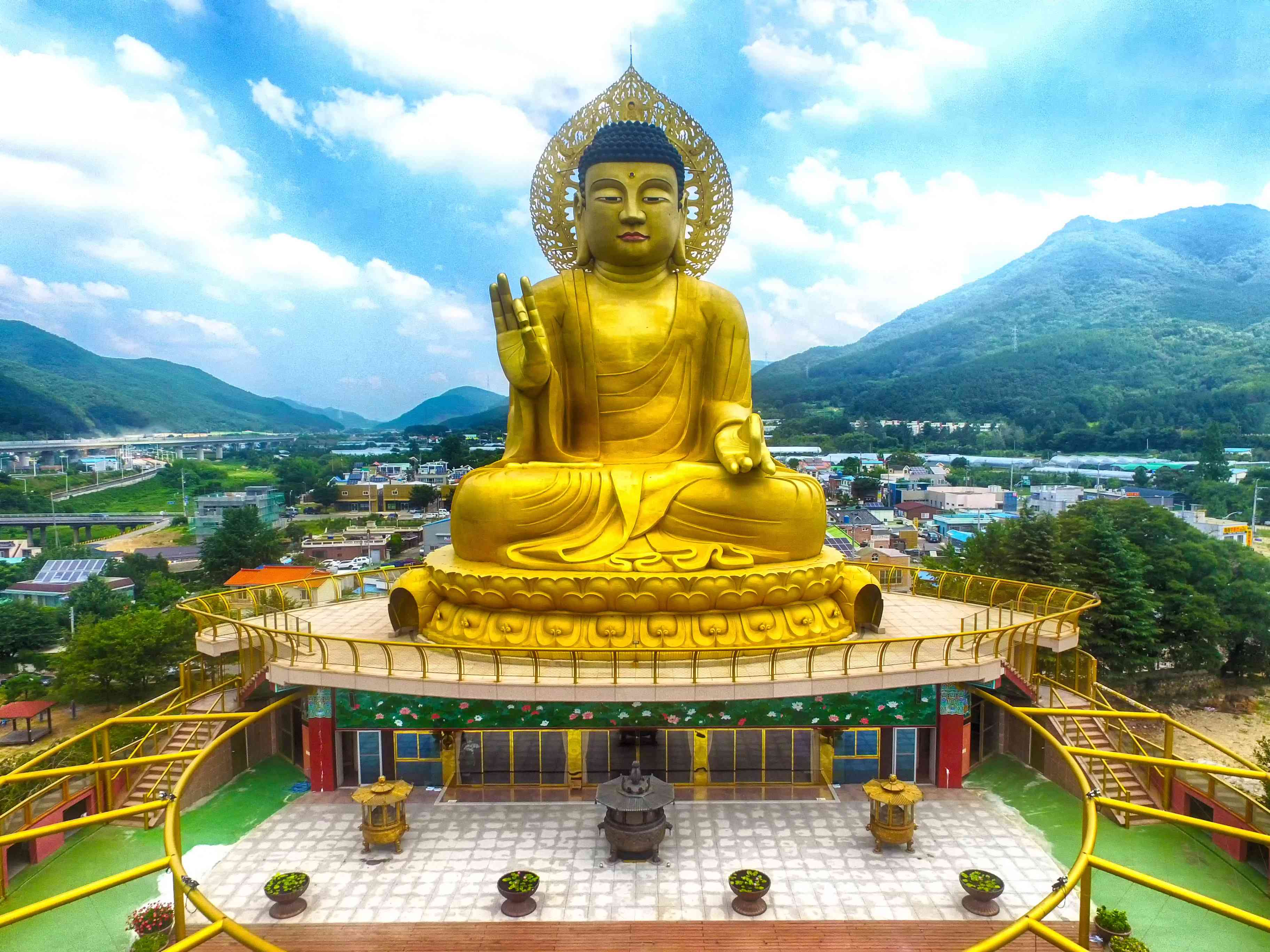 Aerial view of Massive Buddha statue at Hongbeopsa Temple in Busan, South Korea, Asia