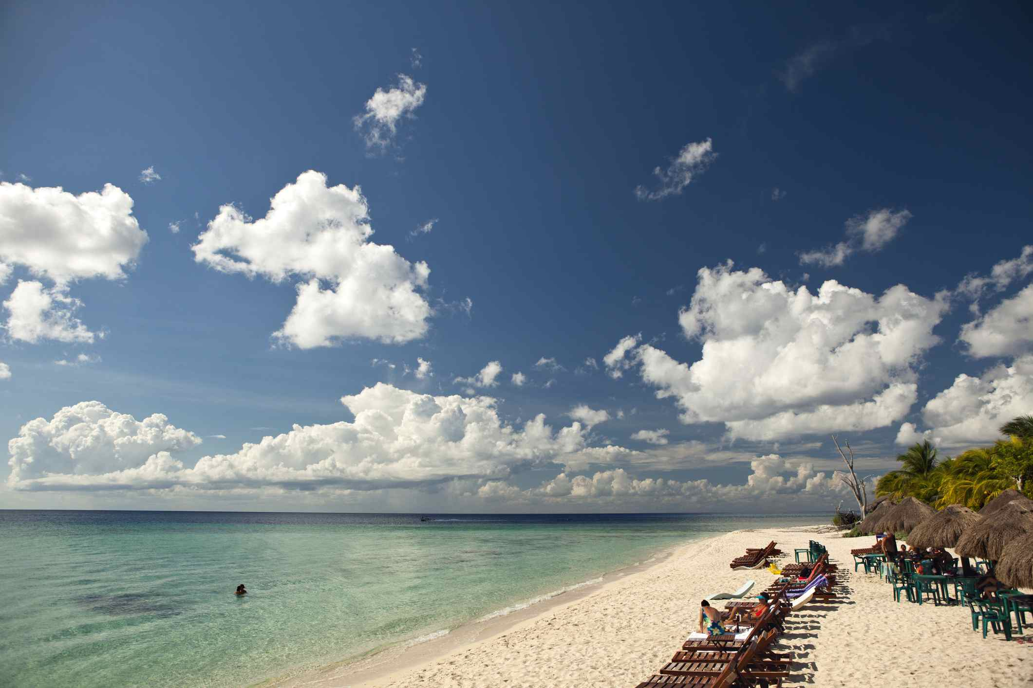 People laying out on a beach in Cozumel, Mexico
