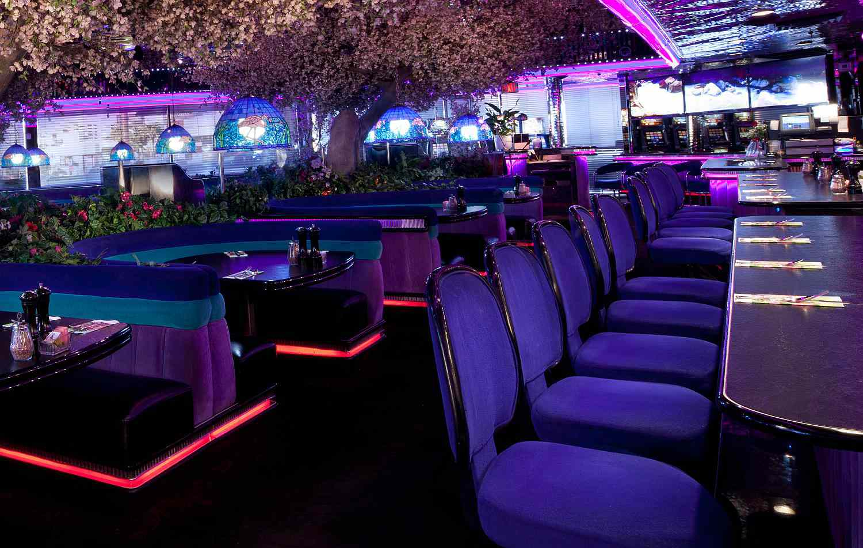 Velvet booths in a purple and blue Las Vegas restaurant