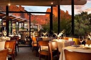 Outdoor dining table with red rock formations in the background