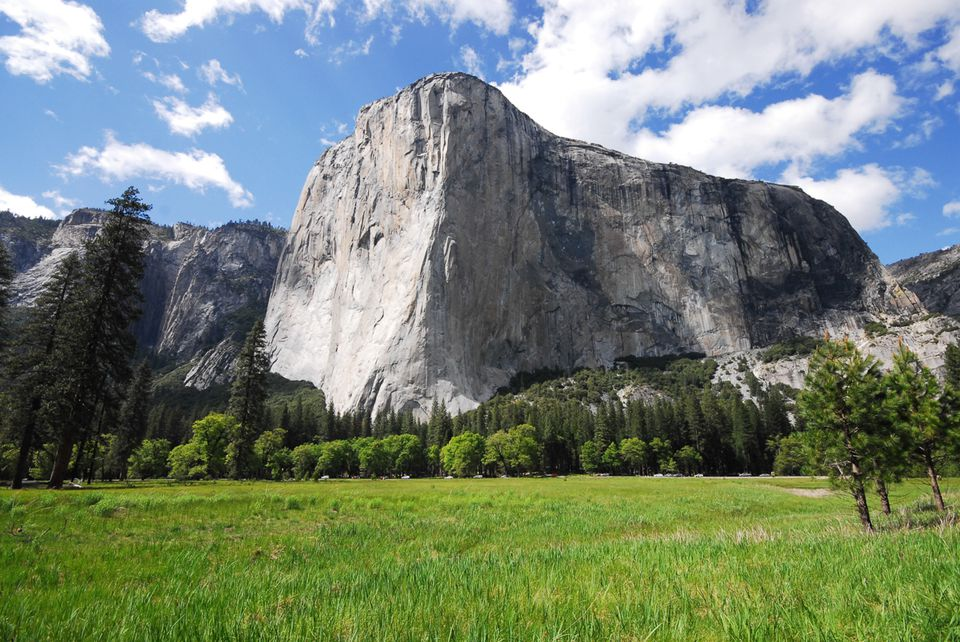 High mountains with a green grassy valley in Yosemite
