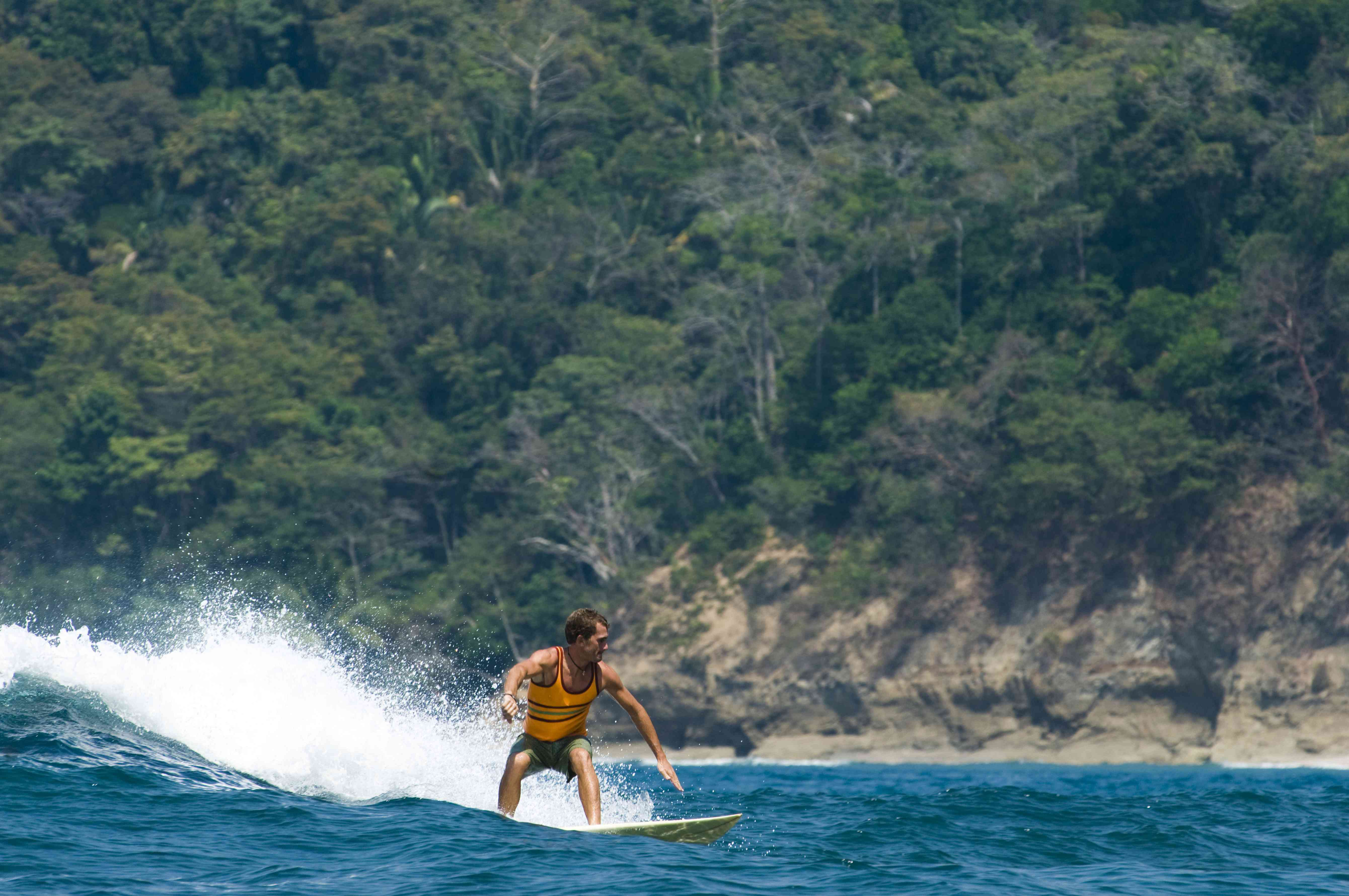 A young man surfing in Costa Rica
