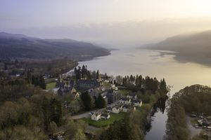 aerial view of and estate on the banks of Loch Ness in Scotland on a hazy day