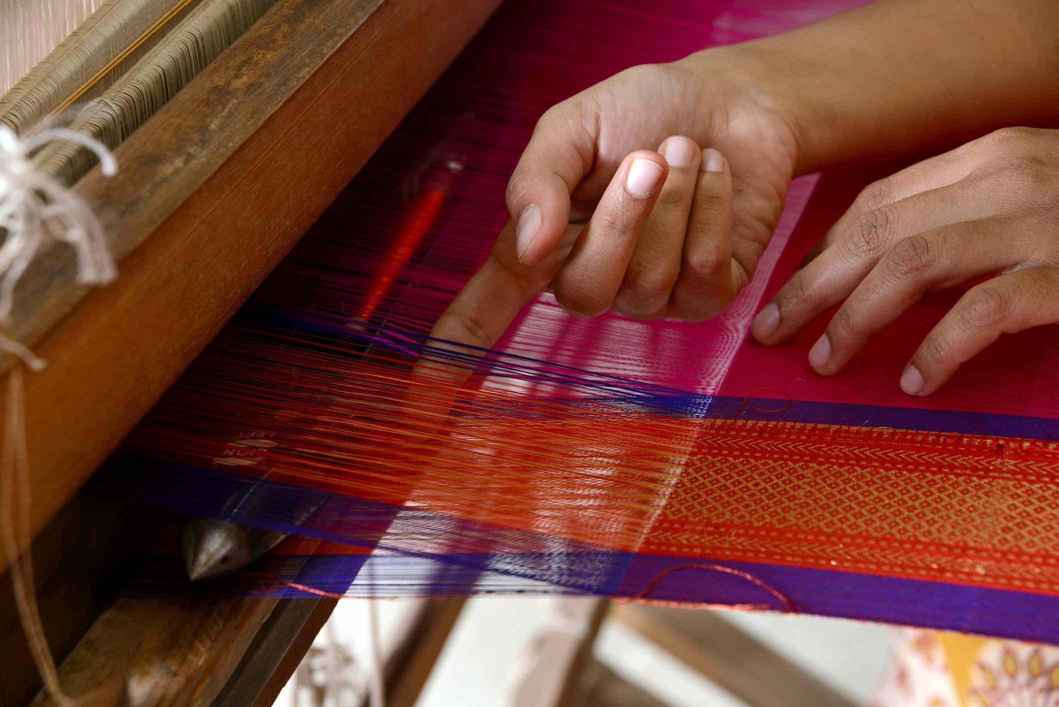 Weaving a sari in India.
