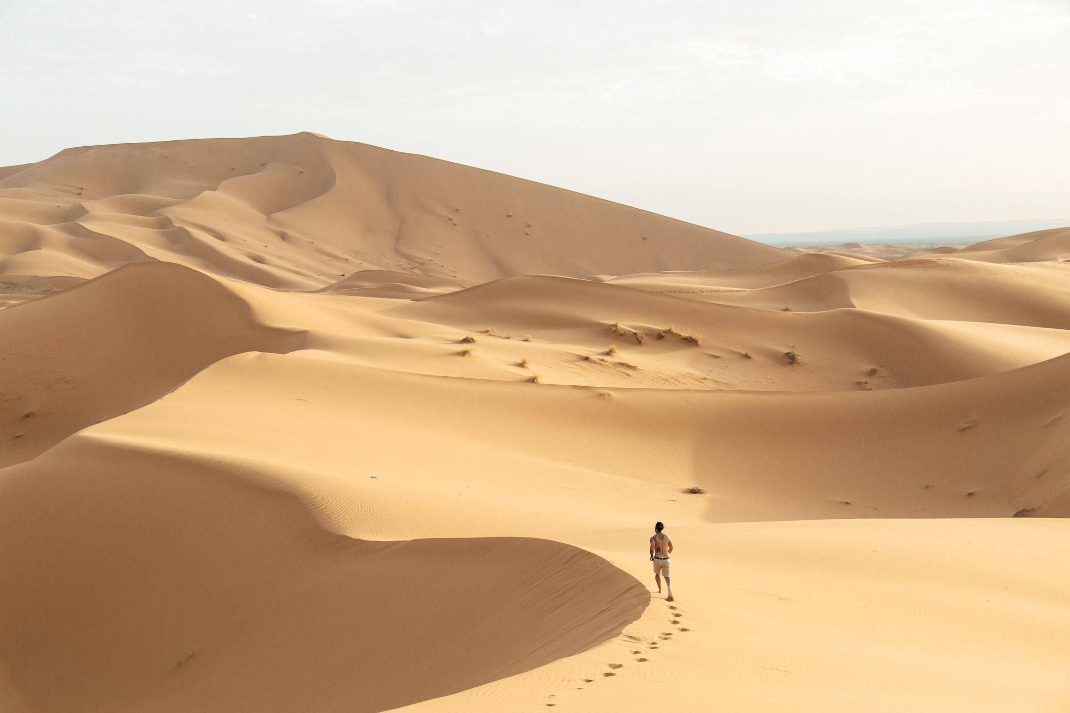 Man runs alone through the Sahara Desert, Morocco