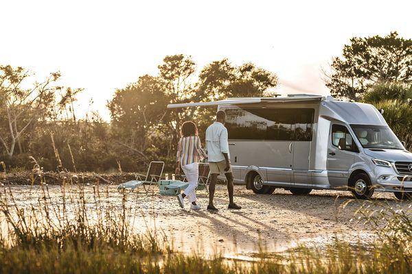 Airstream Atlas campervan at beach