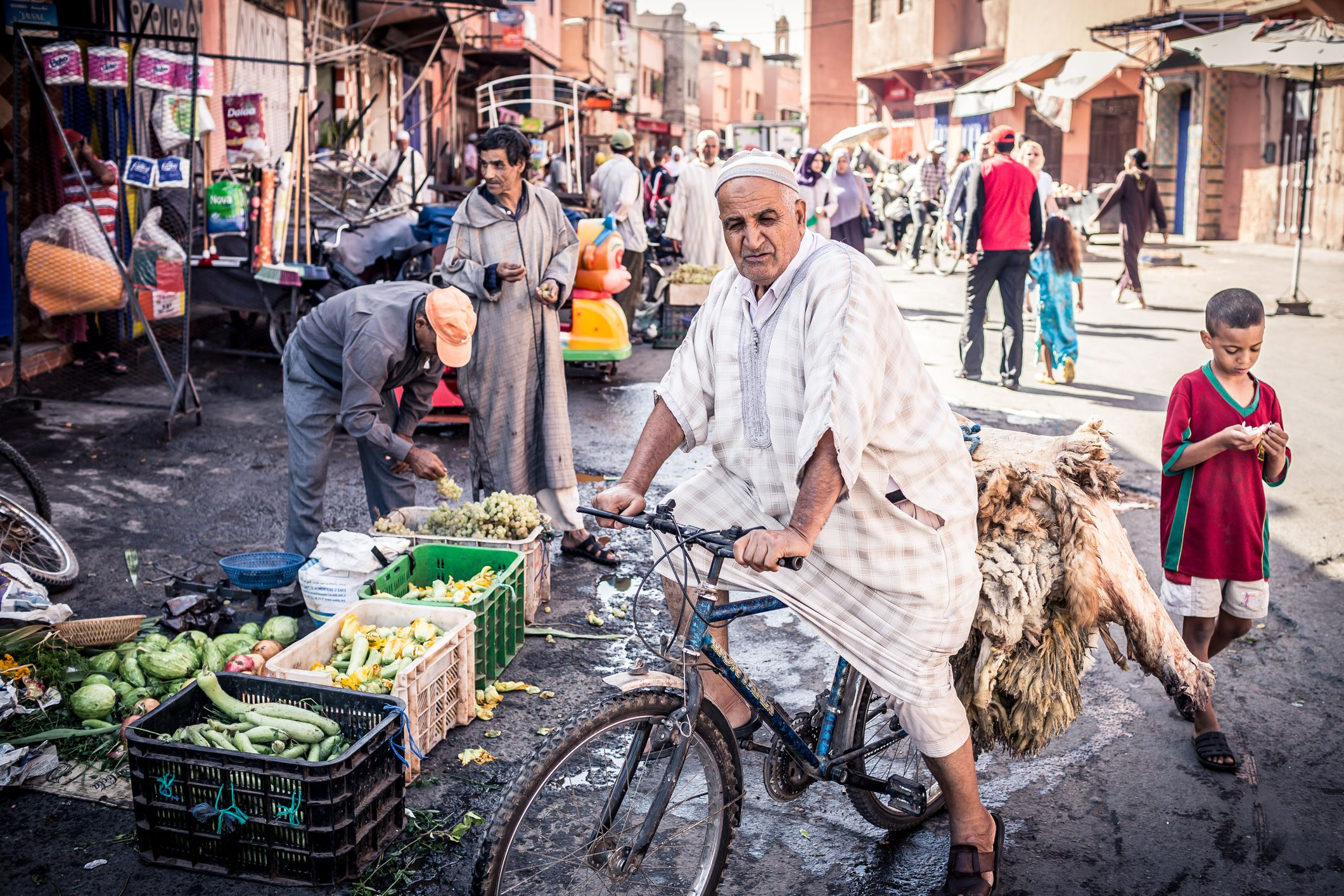 Street scene with Moroccans shopping for Eid ul-Adha