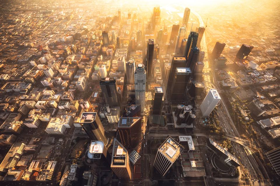 Downtown Los Angeles during a hazy sunset from a helicopter