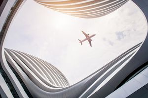 Commercial plane flying over the Beijing airport
