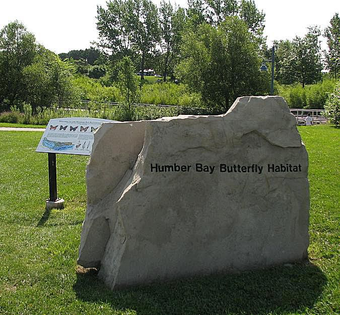 Visitors to the Humber Bay Butterfly Habitat are welcomed with one of the many butterfly perching/sunning boulders, and an interpretive sign.