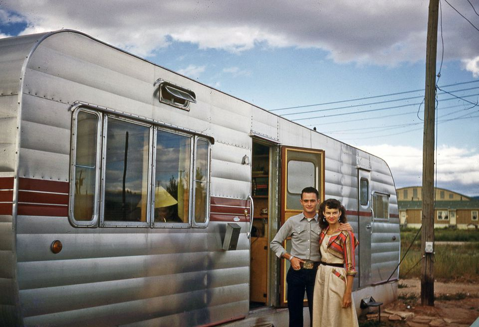 Old timey couple outside their RV
