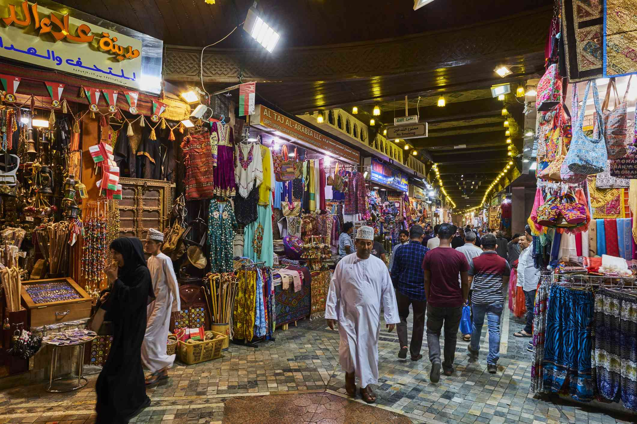 People walking through a traditional market in Muscat, Oman