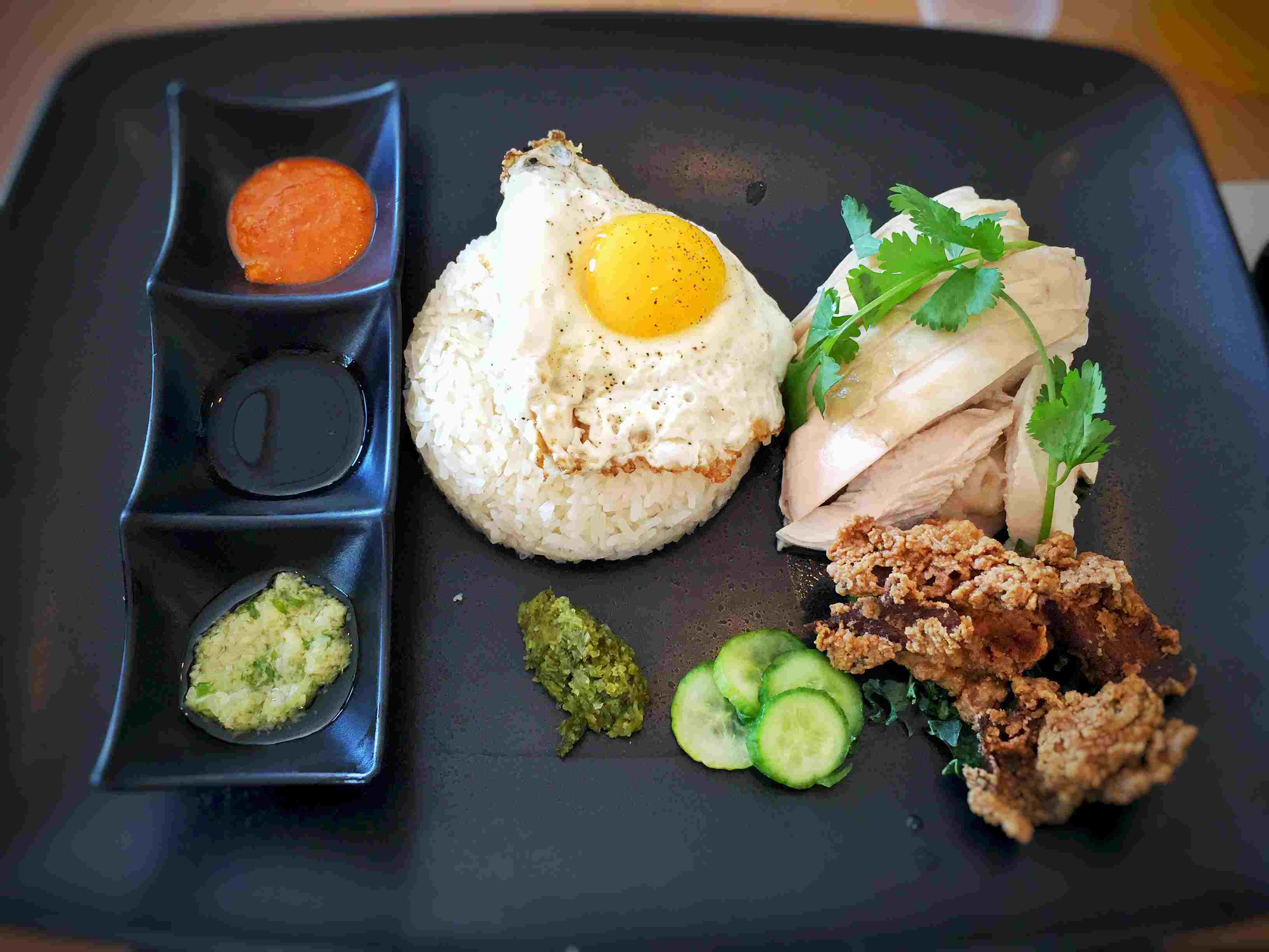 Hainanese chicken rice with fried egg and buttermilk fried chicken skin at Flock and Fowl