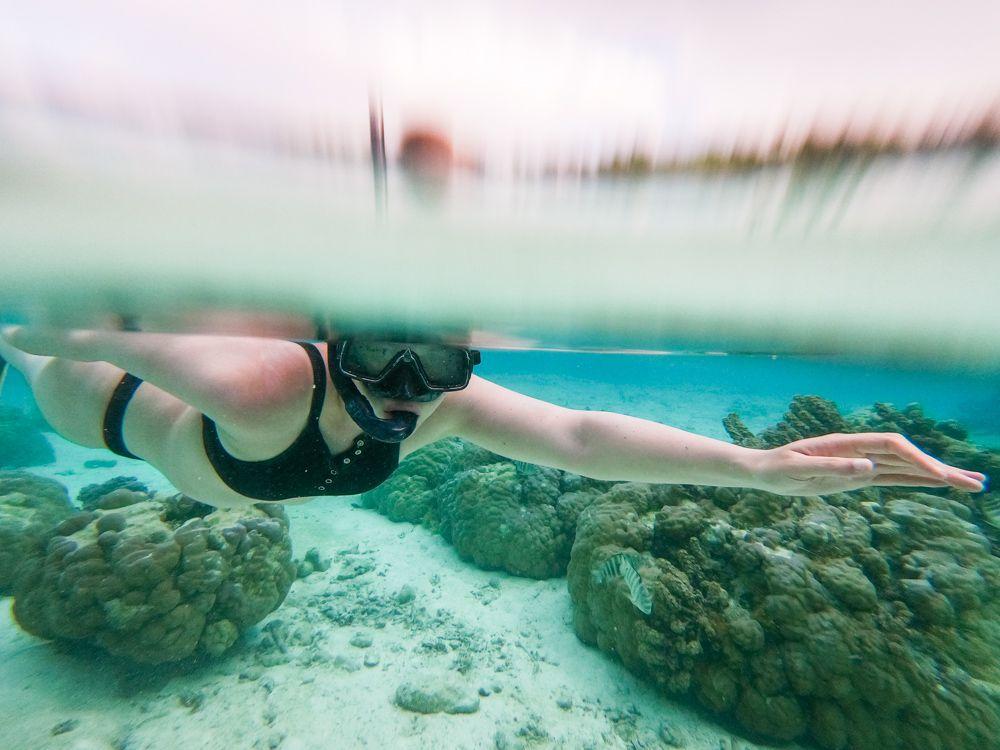 A woman snorkeling in Tahiti