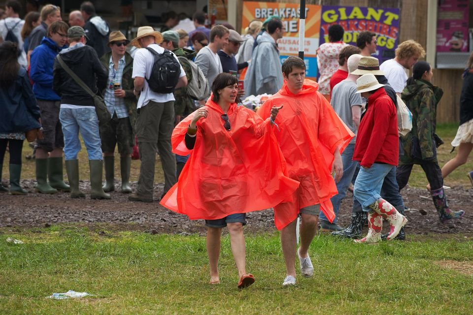 Red ponchos at Glastonbury