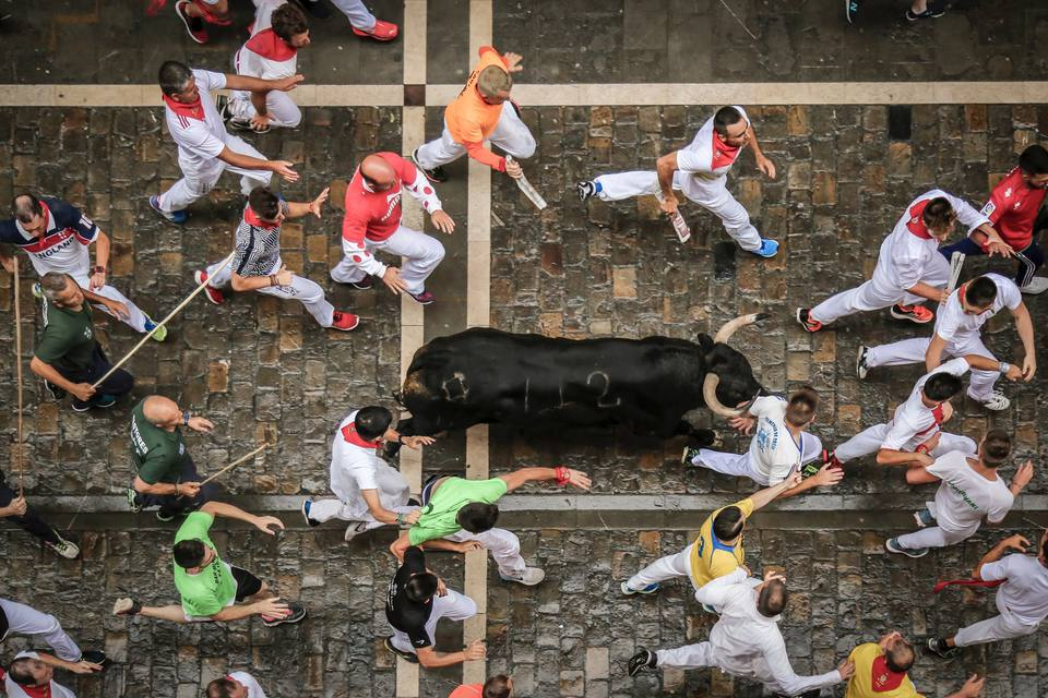running with the bulls at the Sanfermines festival in Pamplona, Spain
