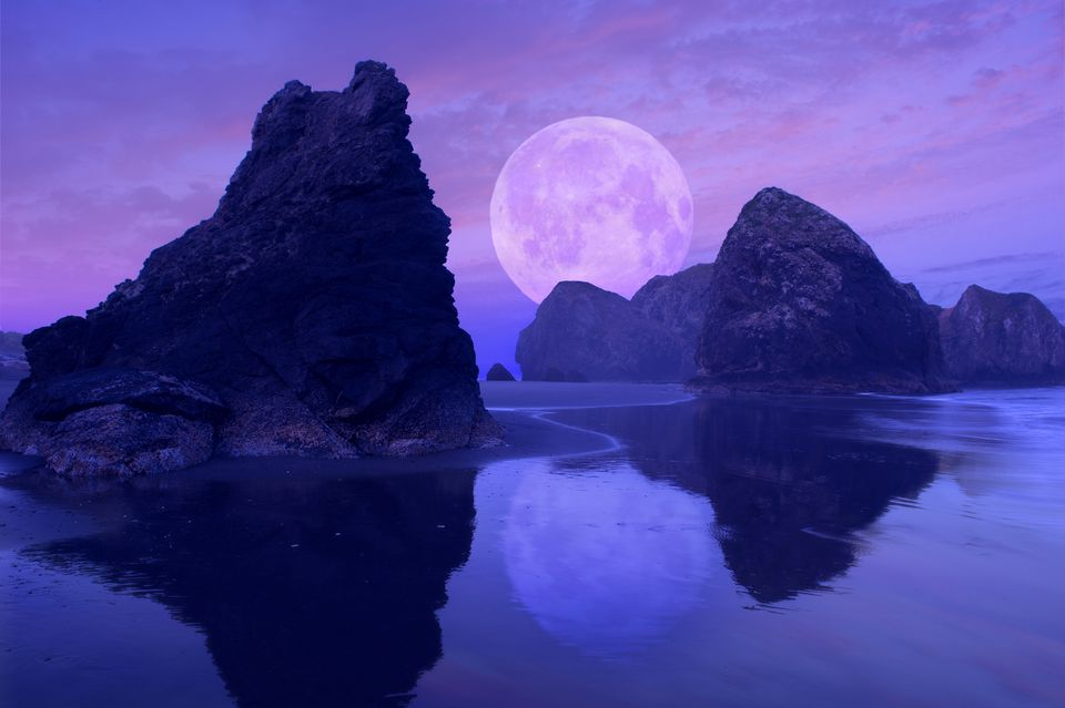 Moon Over Rock Formations On Beach Gold Oregon United States