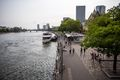 People walking along the river promenade in Frankfurt