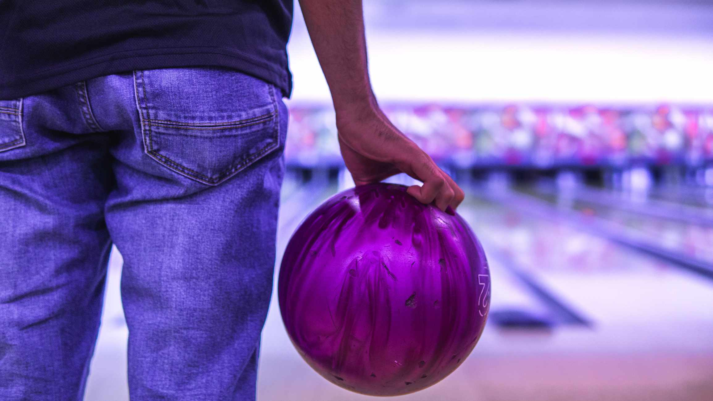 Midsection Of Man Playing Ten Pin Bowling